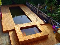 photos de poses de piscines semi enterrées en bois par odyssea