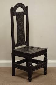 18th Century And Later Heavily Carved Oak High Back Hall Chair ... Rare Antique 19th Century American Gothic Handcarved Solid Oak High Back Black Leather Upholstered His Her Throne Chairs Vintage Handcarved Cane Highback Hooded Chair Set Of 8 62 Arts And Crafts Carved Oak Ding Chairs High For Kitchen Table Spanish Conquistador Contemporary Carved Wood Side 43 Sandy Brown Linen Natural Cedar Accent 31092775 About Us Italian Renaissance Style 20th Cent Mahogany Throne Chair With Lion Arms A Back Crest Stretcher Brown Country Armchair C Spning Bedroom Seating Russian Arm Newel Bishops Occasional Blue Lion