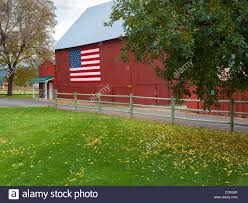 Chelan County, Washington: Historic Red Barn With An American Flag ... Red Barn Washington Landscape Pictures Pinterest Barns Original Boeing Airplane Company Building Museum The The Manufacturing Plant Exterior Of A Red Barn In Palouse Farmland Spring Uniontown Ewan Area Usa Stock Photo Royalty And White Fence State Seattle Flight Interior Hip Roof Rural Pasture Land White Fence On Olympic Pensinula