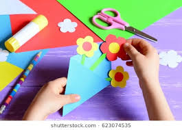 Small Child Makes Paper Crafts For Mothers Day Or Birthday Doing Flowers