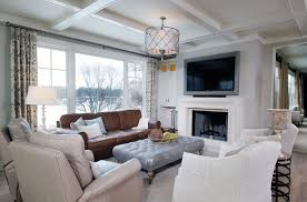 Neutral Living Room Painted In Revere Pewter By Benjamin Moore Limestone Fireplace Whitewashed Hardwood