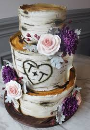 Rustic Chic Three Tier Wedding Cake Accented With Pink And Purple Flowers Featured