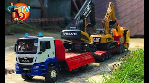 BRUDER Truck Excavator Volvo And CAT Transport To Construct! - YouTube Bruder Toys Man Tipping Truck W Schaeff Mini Excavator 02746 Youtube Bruder Truck Dhl Falls Into Water Trucks For Children Scania Timber Pimp My My Amazing Toys Cement Mixer Model Toy Truck Which Is German Sale Trucks Side Loading Garbage Review 02762 Hecklader Mll Lkw Operated By Jack3 Bruder Dodge Ram 2500heavy Duty2017 Mb Sprinter Animal Transporter 02533 Tractor Case Plowing With Lemken Plow Kids Video World Cat Excavator Riding In The Mud Videos Children Chilrden Matruck Played Jack 3