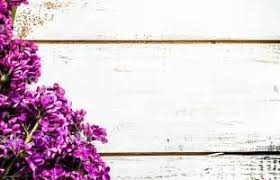 Beautiful Lilac Flowers On Rustic Wooden Planks Background