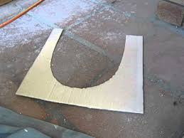 cutting tiles around a toilet the floor is dished not level
