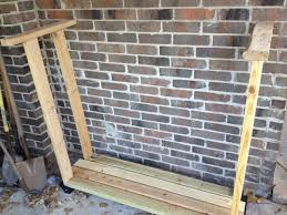 simple diy outdoor backyard firewood rack storage with brackets