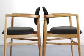 Set Of Two Mid Century Modern Accent Chairs In Blonde Oak And Black ... Set Of Two Mid Century Modern Accent Chairs In Blonde Oak And Black Find More Table With Leaf 4 150 Poos New Price Shop Copper Grove Siuslaw Finished Ding Chair 2 Riga 5 Pce Suite Focus On Fniture Simpli Home Draper 7piece With 6 Upholstered Crown Range Ltd Scanstywheorblackdingchairwithnaturaloaklegs New Nord 79500 Port Extendable By Harry Ostergaard The Vintage Room Room Ideas Ladder Back