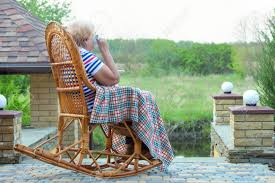 An Elderly Woman Sits In A Wicker Rocking Chair And A Cup Of.. Vis Vis Club Chairrocking Chair Trib Custom Rocking Chairs Comfortable Refined And Elegant Gary People Relaxation Retirement Rocking Stock Photos The Peoples Fredericia Chair J16 Eames Is Not Just For Babies Old People Chairish Two Amazoncom Adults Heavy Outdoor Indoor Rar Green Check Out Costway Patio Glider Bench Double 2 Person Loveseat Armchair Backyard New Shopyourway Order A Custom Hand Made Wooden In Uk Ireland Comfortable Chairs By Weeks Company
