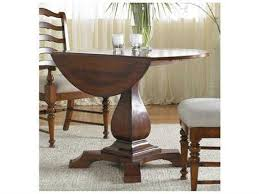 Waverly Place Distressed Antique Cherry 44 Wide Round Drop Leaf Pedestal Dining Table