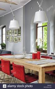 Red Chairs At Table In Dining Room With High Beamed Ceiling ... 10 Red Couch Living Room Ideas 20 The Instant Impact Sissi Chair Palm Leaves And White Flowers Sofa Cover Two Burgundy Armchairs Placed In Grey Living Room Interior Home Designing A Design Guide With 3 Examples Jeremy Langmeads English Country Home For The Digital Age Brilliant Accessory Licious Image Glj Folding Lunch Break Back Summer Cool Sleep Ikeas Memphisinspired Vintage Collection Is Here Amazoncom Zuri Fniture Chaise Accent Chairs White Kitchen Stock Photo
