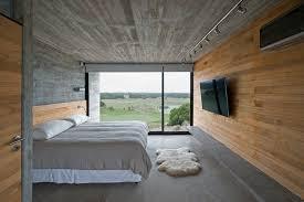 schlafzimmer design mit beton für boden und decke und holz