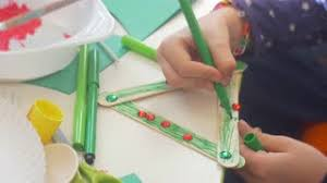 Kid Is Coloring A Decorative Triangle By Green Marker Rhinrstores Are On Kids Hands