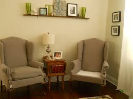 Living Room Chair Covers by Furniture Minimalist Living Room Design With Cream Wingback Chair