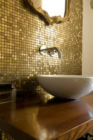 gold bathroom with golden mosaic antique frame mirror gold