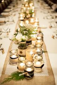 Military Winter Wedding Devils Thumb Ranch DIY Table Center Pieces Mason Jars Candles Assorted Sizes Romantic Warm Lighting