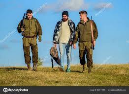 100 Gamekeepers Group Men Hunters Or Gamekeepers Nature Background Blue Sky Guys