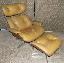 SELIG TAN MOLDED PLYWOOD LOUNGE CHAIR & OTTOMAN Plycraft Eames Lounge Chair Restoration Midcentury Danish Modern Selig Pencil Leg Str8mcm Mid Century Midcentury Arm Vintage Minibus Inc Selig Circular Dark W Black Leather Hijinks Goods Peabody Lawrence Sculptural Lounge Chair Mutualart Pair Of Poul Jsen Z Eames And Style Side Living Ding Pmericana Armchair For In Brown And Teak 1950 Design Market