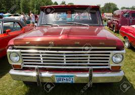 100 F100 Ford Truck IOLA WI JULY 13 Front Of Vintage Red Pickup