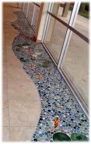 sliced pebble foyer ceramic tile floor with trout fish