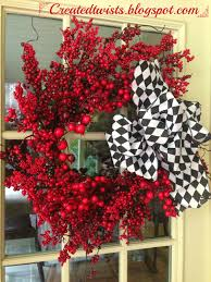 Types Of Christmas Tree Leaves by Red Berry Christmas Wreath With Black And White Harlequin Ribbon