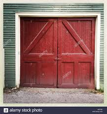 Red, Barn Door Style, Garage Door Stock Photo, Royalty Free Image ... Garage Doors Barn Doorrage Windows Kits New Decoration Door Design Astound Modern 20 Fisemco With Opener Youtube Large Grey Steel In Style White With Examples Ideas Pictures Megarctcom Just Best 25 Pallet Door Ideas On Pinterest Rustic Doors Diy Barn Hdware Hinged For Medallion True Swing By Artisan Worn Wood And Metal Stock Photo Image 16407542 Exterior Sliding Good The