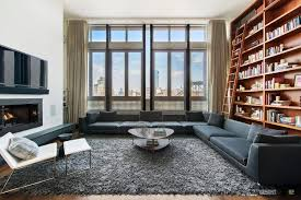 bright living room interior with deluxe gray sofa and fireplace