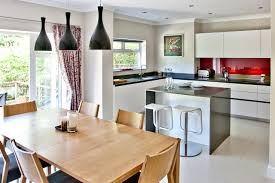 Mid Sized Trendy Kitchen Dining Room Combo Photo In Surrey With Gray Walls