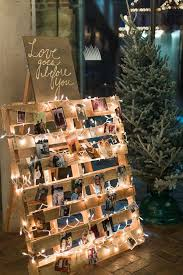 Wedding Decor Using Wooden Palette Fairy Lights Polaroids Of Guests