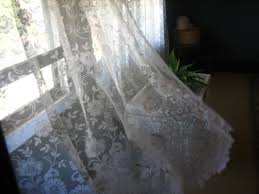 Sheer Curtain Fabric Crossword by Lace Curtain Irish Definition Curtains Gallery