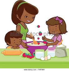 Mother And Children Cooking In The Kitchen