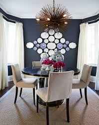 Eclectic Dining Room With Dark Blue Paint Color And Ivory Pinch Pleat Silk Curtains Covering Windows