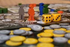 Some Of The Pieces Jonny Pac Cantins New Board Game Hangtown Are Photographed