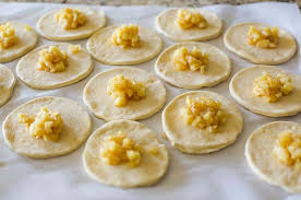 Dough Circles Topped With Apple Filling For Hand Pies