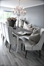 Grey Rustic Dining Table With Beautiful Fabric Chairs The Combination Is Modern And Elegant