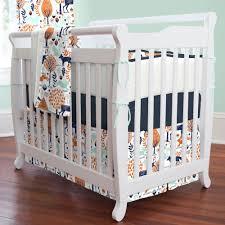 Woodland Themed Nursery Bedding by Navy And Orange Woodland Mini Crib Bedding Carousel Designs