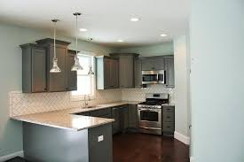 gray cabinets with white subway tile herringbone backsplash tiles