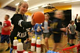 Frank Hobbs Elementary Grade 5 Student Keeley Delaney Shoots The Ball Into Her Teams Basket Bowling Game During Schools Cardboard Maker Carnival On