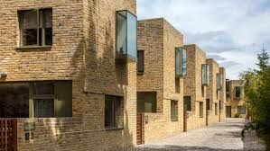 100 Mews Houses Peter Barber Uses Oriel Windows For Facades Of Moray Houses