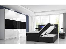 schlafzimmer mit boxspringbett mit zwei bettkästen