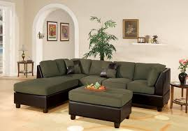 living room grey leather sectional and brown wooden floor also