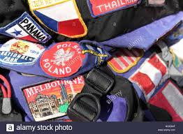 Section Of A Well Worn Travel Backpack That Is Covered In Sewn On Patches Counties And Places Visited