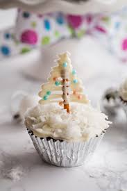 Delicious Festive Gingerbread Cupcakes With Cream Cheese Frosting Add Some Cute Pretzel Christmas Tree