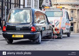 A Hearse Being Towed By A Tow Truck In Ripon, UK Stock Photo ... The Subliminal Tow Truck Crooked Halo Truck Being Towed Usa Stock Photo 780896 Alamy Home Dab Towing Recovery Motorcycle Roadside Different Types Of Commercial Vehicles We Gs Service Moise Assistance Services In Ontario Arlington Driver Hooks Car With Children Inside Nbc4 Newer Nypd Traffic Division Tow Trucks Picking Up Iegally Parked Broken Down Auto Vehicle Towed Onto Flatbed A Hearse By A Tow Ripon Uk Someones Figured Out Flproof Way Preventing Your Getting Pell City Al 24051888 I20 Alabama