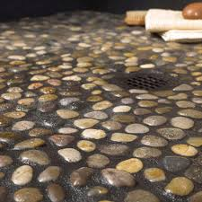 river rock shower floor black glass subway tile patterns bathroom