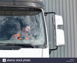 Driver Looking In Truck Mirror Stock Photo: 276787308 - Alamy Woman Truck Driver Looking Out The Door Of A Big Rig From Stock Driver Shortage In Industry Baku Experience Life Trucker Truck On Xbox One Looking In Sideview Mirror Photo Getty Images Military Veteran Driving Jobs Cypress Lines Inc Owner Operator Application Are You For Traing Brisbane We Are Good Garbage Waste Management Trains Senior Throw The Window Picture Male Out Of Image Forwarding Sits Cab His Orange Edit Now 18293614 Guy Pickup At Shotgun Video Footage Videoblocks