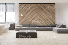 graue sofa wohnzimmer holzwand stockfoto und mehr bilder behaglich