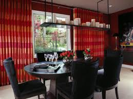 Dining Room With Red Drapes And Unique Chandelier
