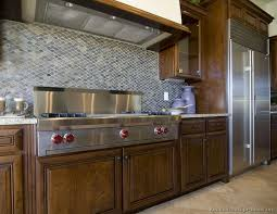 Idea Of The Day Deep Luxurious Dark Walnut Colored Kitchen With Mosaic Tile Backsplash