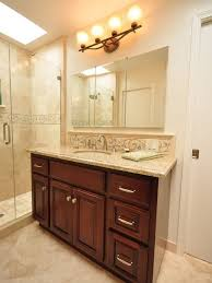 Example Of A Classic Bathroom Design In San Francisco With Raised Panel Cabinets And Dark