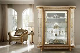 vitrine wohnzimmerschrank hochglanz beige gold abgerundet